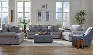 Grey fabric living room set including the Lockwood Granite couch, loveseat, armchair, swivel chair and ottoman.
