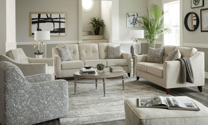 Room shot of the Harleston Cream Set including the sofa, loveseat, armchair, swivel chair and ottoman.