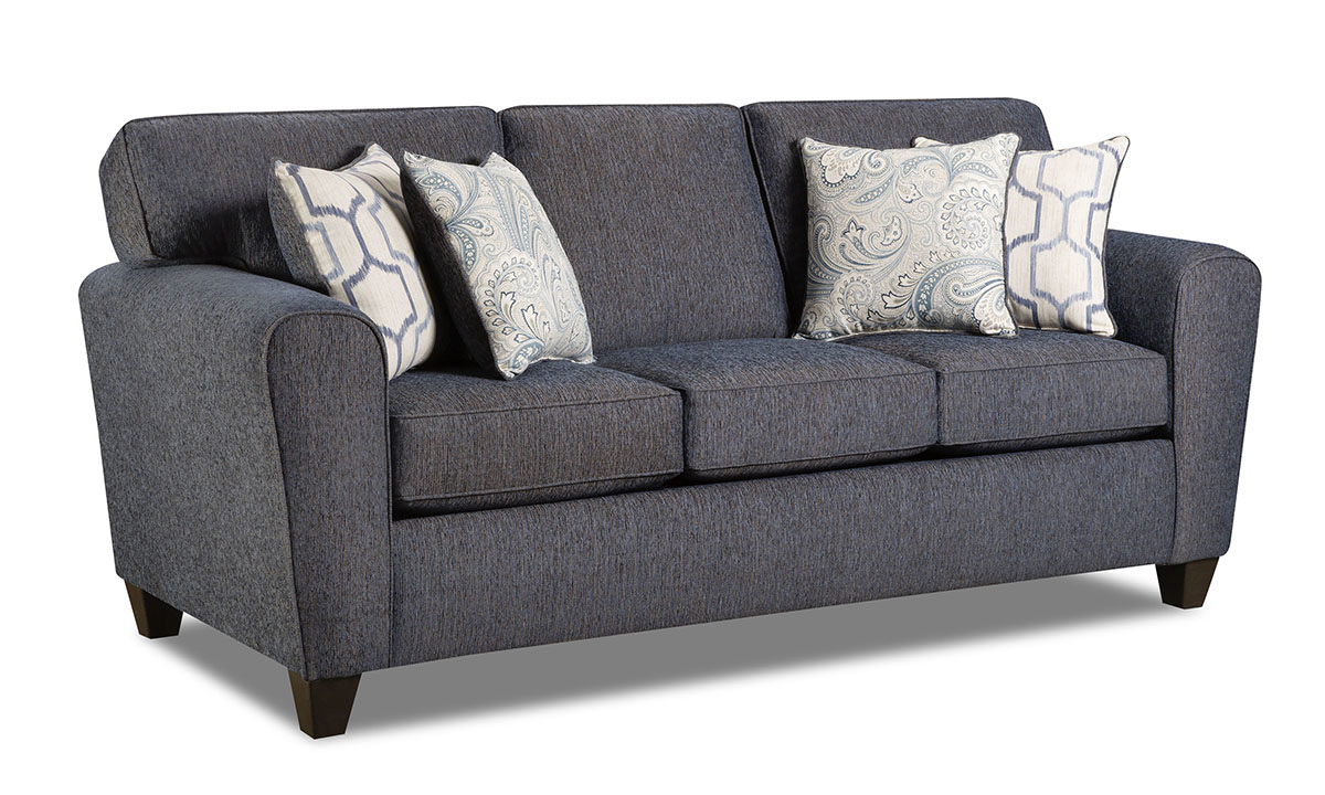 Denim blue sofa features stain resistant fabric and four coordinating throw pillows