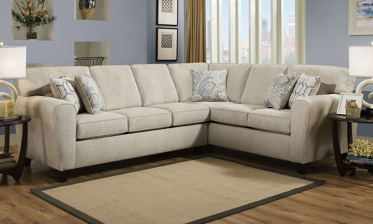 Cream-colored stain-resistant fabric sectional with contemporary dome-shape armrests