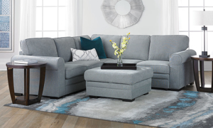 Alternate configuration of the corner-shaped grey fabric sectionals with pop-up sleepers.
