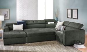 Grey fabric sectional with pop-up sleeper and adjustable headrests.