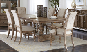 Cardoso Sandstone table with two arm chairs and four side chairs.