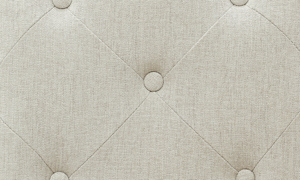 Detailed image of the Cardoso Sandstone chair upholstered in a neutral beige.