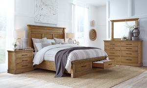 Affordable king sized storage bed from Aspenhome and  two nightstands.