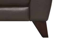 Tapered walnut legs on the Violino Pewter Leather Sofa.
