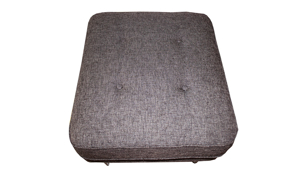 """25"""" wide ottoman featuring button tufting and tapered wood legs."""