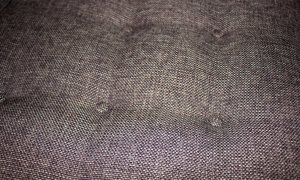 Button Tufting in a sunset brown polyester fabric.