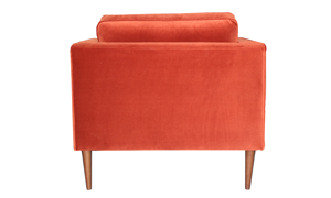 70s inspired accent chair by Carbon in a rust orange velvet.