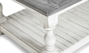 Coffee table in neutral colors of white and gray.