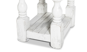 Chairside table in neutral colors of white and gray.