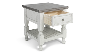 Crafted from solid wood with a weathered grey and ivory finish.