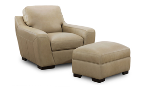 Contemporary leather chair and ottoman in a neutral taupe color.
