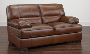 """67"""" loveseat made of top-grain leather in a chestnut brown."""