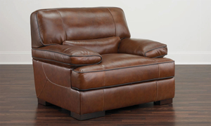 Leather arm chair with cotrast welting creates a statement in your living room.