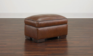 Leather ottoman made from top-grain leather.