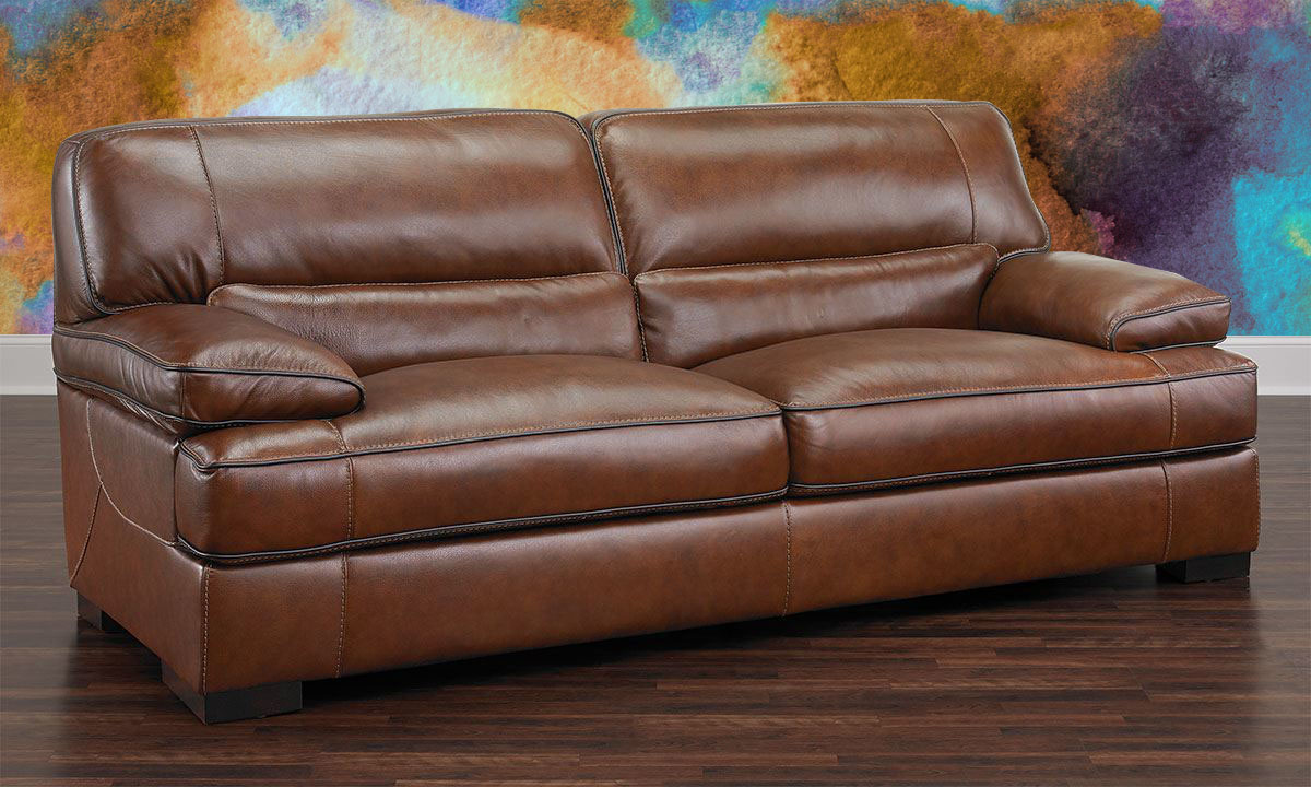Classic and contemporary brown 90-inch top-grain leather sofa with 41-inch deep cushions on wood floor
