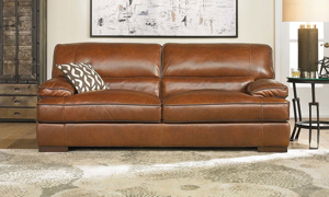Pillowtop arms on a luxury leather couch available at Haynes Furniture.