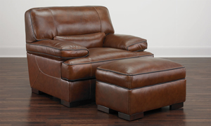 Contemporary armchair and ottoman set in brown top-grain leather atop wooden feet