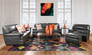 Contemporary leather living room set includes sofa, loveseat, chair and ottoman.