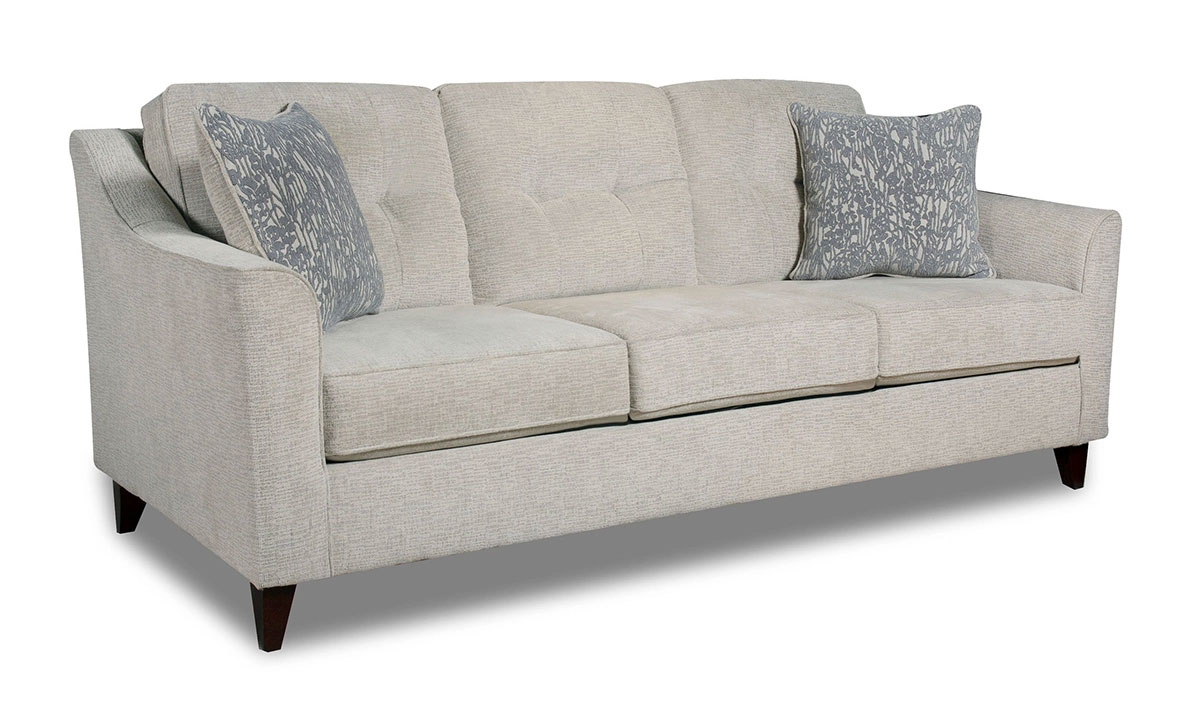 Harleston Cream Sofa with coordinating throw pillows and beige fabric upholstery.