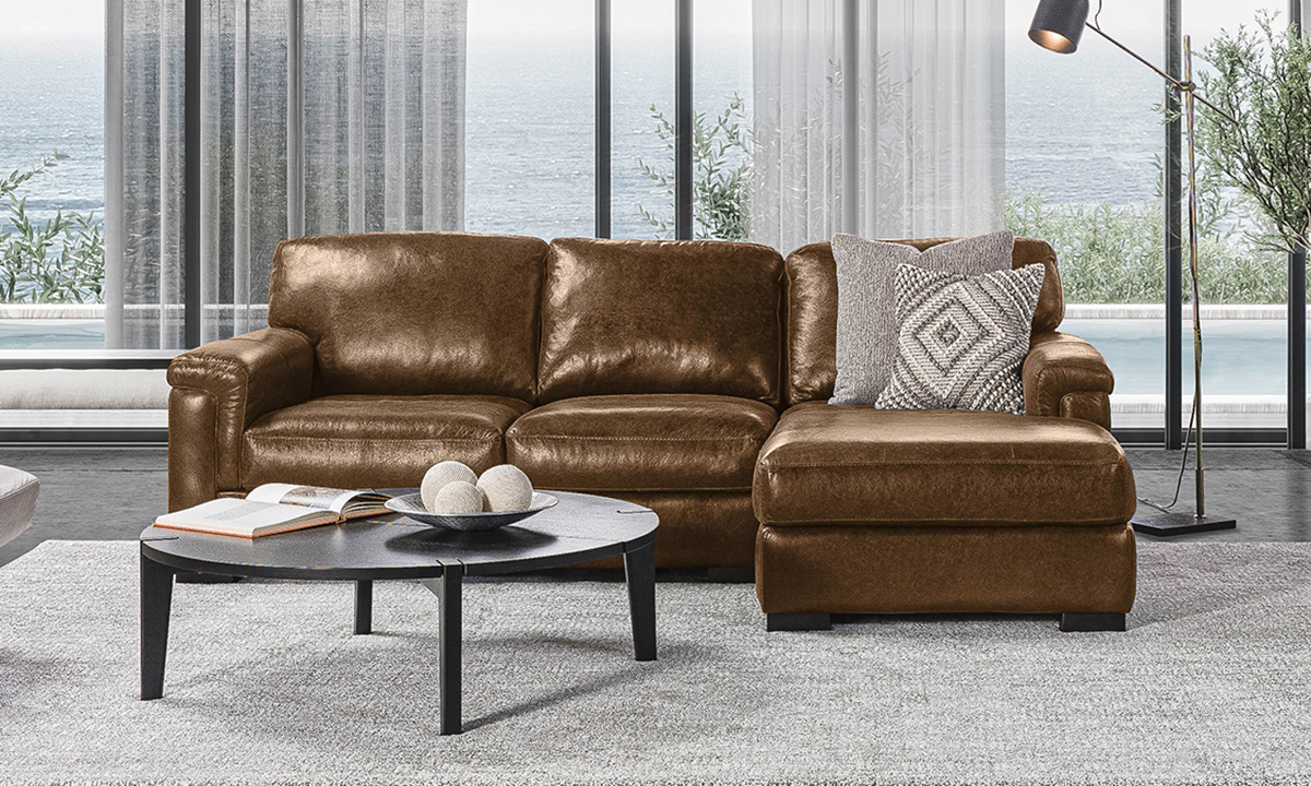 Lifestyle image of the Medici Chestnut leather sofa chaise.