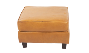 American-made top grain leather ottoman in a warm Butterscotch brown color.