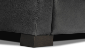 Detail shot of the Medici Grey Leather Seating Collection solid wood feet and Italian top grain leather finished with decorative stitching accents.