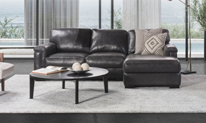 Premium Italian leather on a grey sofa chaise from Spagnessi.