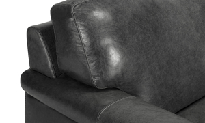 Close up shot of the Medici Grey Leather Collection illustrating the premium craftsmanship, low-slung profile and backrest, and decorative stitching details.