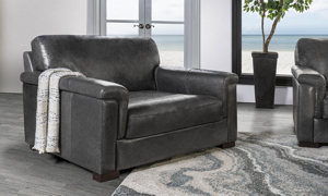 Complete the Medici Collection with this grey leather accent chair.