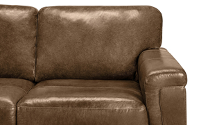 Closeup detail shot of the Medici Chestnut Leather Loveseat layover armrest tailored in brown top grain leather with decorative stitching accents.