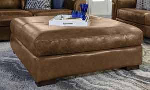 Lifestyle image image of the chestnut brown Italian leather Medici ottoman.