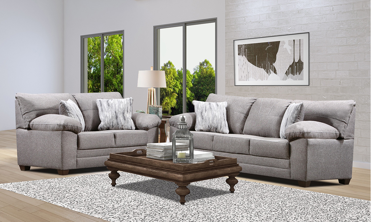 Zora Grey Set includes sofa and loveseat in a neutral grey tone with two toss pillows in an abstract pattern.
