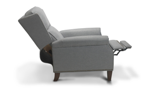 Recline in classic style with the Gifford Recliner featuring neutral hues and nail head trim.