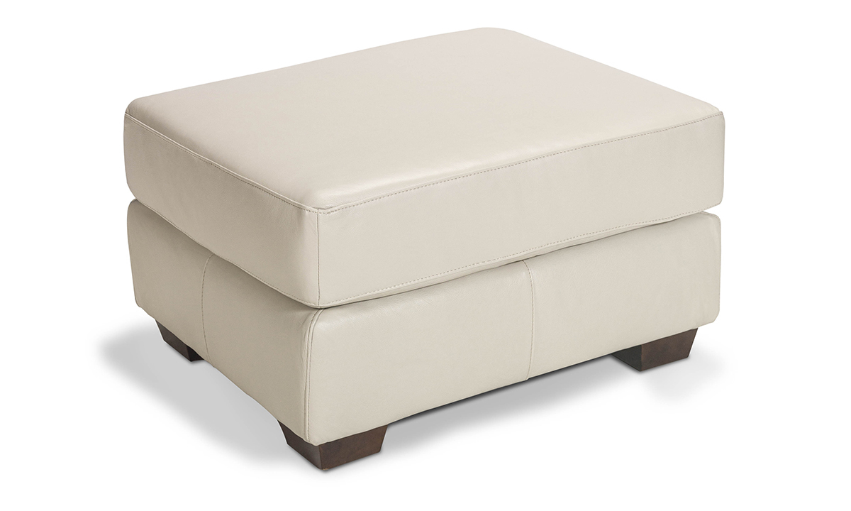 Rectangular ottoman with off-white top grain leather.