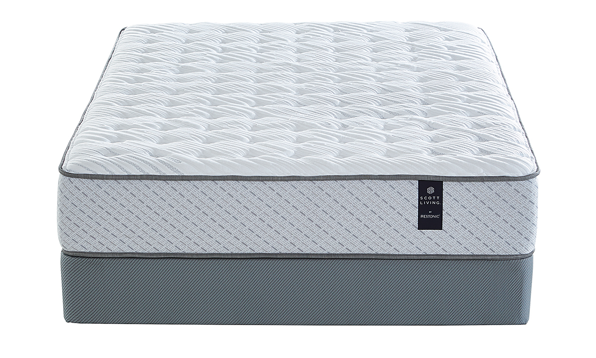 Extra firm mattress from Scott Living with a cooling fabric cover.