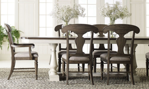 """Trestle table that goes from 84"""" to 120"""" that includes 4 chairs."""