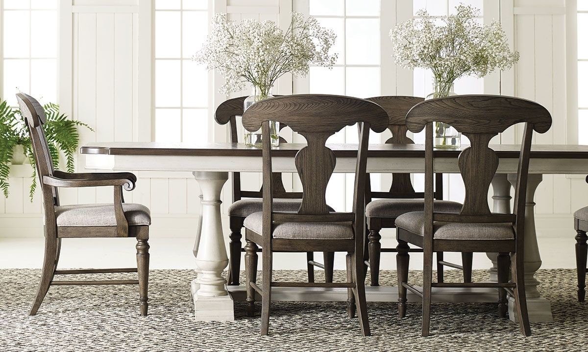 Dining set includes extendable table and six chairs.