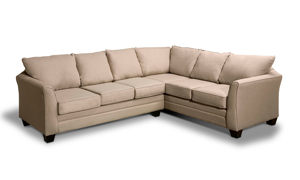 Tan fabric sectional made from a hardwood frame.