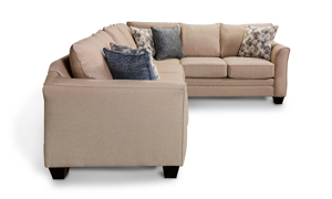 London sectional from J Furniture in beige that includes throw pillows.