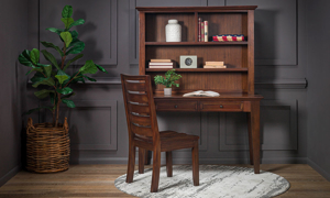 Home office set includes a mahogany desk and matching chair.
