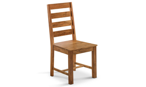 Solid wood dining room chair that was handcrafted by skilled artisans in India.